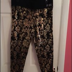 Black and gold PINK leggings. Black leggings with gold detailing. Only worn one time. In great, like new condition. Very rare, have never seen another pair like them. They're so pretty, pictures don't do them justice.  NO TRADES PINK Victoria's Secret Pants