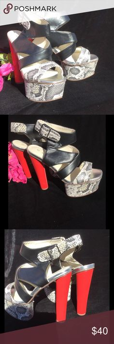 Platform Snake Print Sandals Step Up and Out with these Platform Stunners..Check-out the 6'in red sexy heel coupled with 2 1/2'in snake print platform..Give your legs a new lease on your life..Imagine how chic and sexy you will look with a denim mini crop top or your favorite booty shorts..🚫No trades🚫🚫No Foot Modeling🚫🚫All offers in comment section will be ignored🚫No Low Balling🚫 C-Label Shoes Platforms