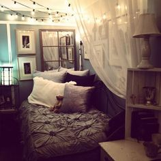 Love the sheer curtain, lights and window mirror