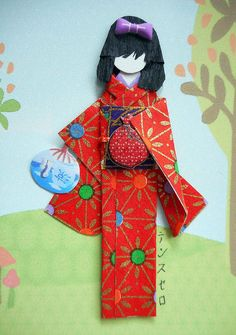 "Card made using Japanese light cardstocks, background image from Cricut, *yuzen washi"" for kimono and obi, fan paper cutout and epoxy self adhesives for accessories. Card size: 16.5 cm x 12 cm Doll height: 8.3 cm"