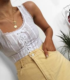 Lace up white top yellow jeans