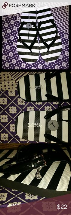 NWT Michael Kors black & white flip flops NWT Michael Kors black and white striped flip flops. Silver hardware features MK signature on each shoe. Soles are black and have Michael Kors on them. A must have for this season! Serious offers only. Bundle and save. Free gift with every purchase! Happy poshing! Michael Kors Shoes