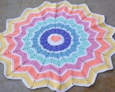 Round Ripple Crochet Pattern. Could be a cute Baby blanket