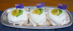 Pavlova, is a famous dessert named for the Russian Ballet dancer Anna Pavlova. The dessert is like a meringue, topped with fresh fruit, most often kiwifruit. Doesn't it look delicious?