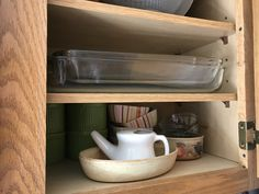 The old shelves look like this. It will look odd if the inside of the cabinets don't match. Need to make it look good but perhaps it doesn't all need to be redone inside - I need to see it. The front strip matching old cabinets should probably be redone.