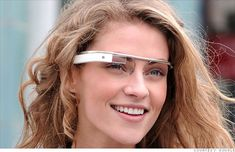 """Google unveils 'Project Glass' virtual-reality glasses: The company on Wednesday unveiled a long-rumored concept called """"Project Glass,"""" which takes all the functionality of a smartphone and places it into a wearable device that resembles eyeglasses.The see-through lens could display everything from text messages to maps to reminders. They may be capable of showing video chats, providing turn-by-turn directions, taking photos and recording notes"""