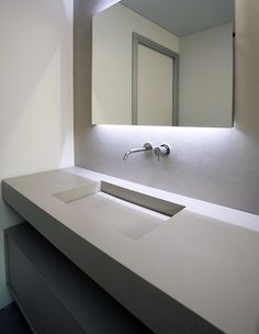 Minimalist bathroom, custom sink in cristalplant by Antonio Lupi _