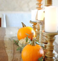 Candlesticks and pumpkins all in a row