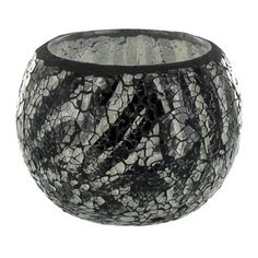 "This Zebra Mosaic Glass Roly Poly Votive Holder makes a beautiful display for candles and more. The holder measures approximately 4 3/8"" x 3 3/8""."