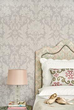 Grey, pale pink, pale green. Delicate pattern on pattern in this feminine bedroom.