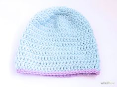 How to Crochet a Baby Hat. Baby hats can be a moderately challenging project for beginning crocheters, but with a little practice, you can craft a variety of designs using only a few basic stitches. Tie the yarn onto the crochet hook. Bonnet Crochet, Crochet Baby Hats, Crochet Beanie, Crochet Hooks, Knitted Hats, Chain Stitch, Slip Stitch, Half Double Crochet, Single Crochet