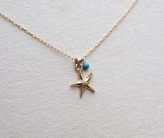 Starfish necklace, Star fish turquoise necklace, Beach necklace, Ocean necklace, Sea necklace, tiny gold necklace +starfish charm, sea charm  Delicate gold necklace with starfish charm and little turquoise bead. Small pendant and blue gem stone on the thin gold chain make this marine necklace dainty and special. It is a great gift idea for every woman or girl. You can choose to put a little gold bead between charm and gemstone. See my bigger starfish necklace on the last photo https:/&#x...