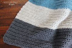 This crochet blanket pattern is extremely simple to make which makes it perfect for beginners. If you would like to make this for yourself just follow along with my pattern below. MATERIALS Lion Brand Yarn Vanna's Choice in Dusty Blue, and Charcoal Grey and Linen. Exact amount needed will depend on the size blanket you wish to make or any worsted weight (4) yarn. Size J Crochet Hook 6.00 mm Yarn needle