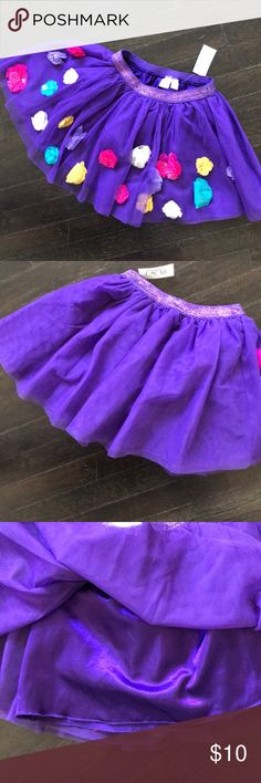 NWT Children's Place tutu skirt NEW! With tags.. Children's Place tutu style purple skirt with 3D flower accents that have gold & silver sparkle dots. Lined in purple satin. Children's Place Bottoms Skirts