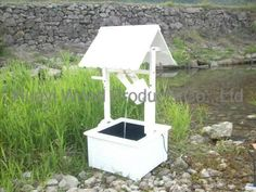 with black roof to match the house... wishing well ...
