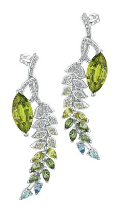 Brins de Printemps #Earrings from #LesBlesDeChanel - #Chanel - #FineJewelry collection in 18K white gold set with 2 #MarquiseCut - #Peridots (10.4 cts), 4 marquise cut peridots (1 carat), 20 #Brilliantcut peridots, 6 marquise cut #GreenTourmalines (1.4 carat), 4 #PearCut - #Aquamarines and 146 #BrilliantCut - #Diamonds - July 2016