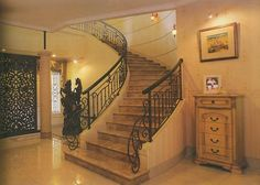 wrought iron & stone curved staircase