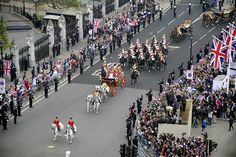 Prince William and his bride Kate, Duchess of Cambridge, travel in the 1902 State Landau carriage along the Processional Route to Buckingham Palace