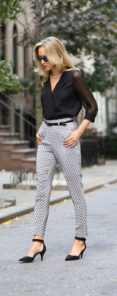 Bold print monochrome trousers, Black blouse business - casual work attire