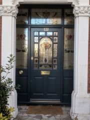 Decorative Edwardian front door painted dark blue with elegant stained glass. Traditional brass door furniture Decorative Edwardian front door painted dark blue with elegant stained glass. Black Front Doors, Wooden Front Doors, Painted Front Doors, Glass Front Door, Dark Doors, Glass Doors, Windows And Doors, Front Door Porch, Front Door Entrance