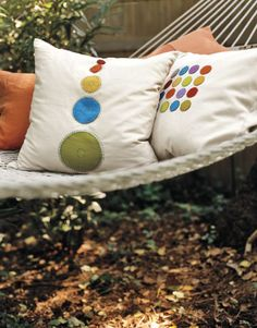 Add some color to your living room with these polka-dot pillows. #crafts