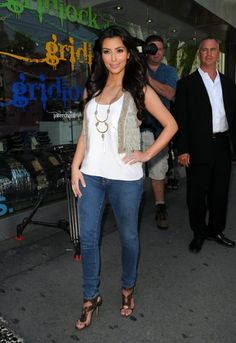 Kim Kardashian wearing J Brand 10 Lowrise Skinny Ankle Jeans 910 in Worn Alexander Wang Silk Pocket Tank Top in White Barron Duquette Ryleigh Vest