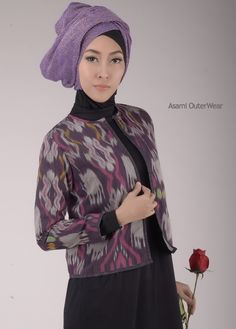 Beautiful simply outerwear with traditional handmade fabric.