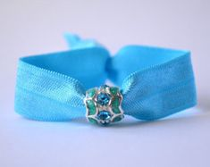 Soft elastic hair tie with aqua ribbon and beautiful glitter charm. No crease hair ties, yoga hair ties, beaded hair ties, stocking stuffer No Crease Hair Ties, Yoga Hair, Trendy Bracelets, Elastic Hair Ties, Hair Beads, Party Favors, Trending Outfits, Purple, Unique Jewelry
