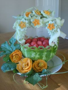 A watermelon fruit basket garnish with celery, melon rind and carrot flower carving to give the piece an elegant look. Fruit Basket Watermelon, Watermelon Art, Watermelon Carving, Edible Crafts, Edible Food, Edible Art, Veggie Art, Fruit And Vegetable Carving, Veggie Food