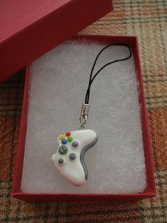 White Xbox Controller Cell Phone Charm. hand crafted out of polymer clay, then coated with a clear protective glaze. $8.50 #keychain #xbox #videogames emokitten21   FREE Samples @ http://twurl.nl/02km5h