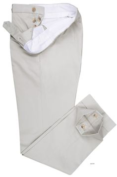 Luxire dress pants constructed in Pale Grey Cream Soft Plain Chinos: http://custom.luxire.com/products/pale_grey_cream_soft_plain_chinos  Consists of extra long extended closure with front slant pockets, button fly, side metal adjusters, 2 rear pockets with buttons and 2″ bottom cuffs.
