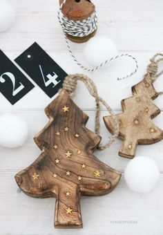 Natural | JFM Christmas Inspiration 2015 | Wooden Christmas tree decorations with candy cane hanging string |