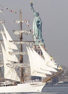 A Magnificent Tall Ship Sailing by the Statue of Liberty