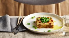 Milk is the base for Tama Carey's creamy sauce that gives you a deliciously cheesy, yet light layered caramelised onion lasagne. Fontina and peas are simply the icing on the cake! Sydney Restaurants, Creamy Sauce, Meat Recipes, Vegetarian Recipes, Food Preparation, Onion, Caramel, Meals, Dinners
