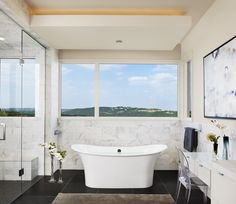"""Austin-based studio James D LaRue Architecture Design designed the House on the Hill project in Austin, Texas, USA. According to the architect, this contemporary gem """"exudes a curb appeal with an inviting entry, expansive glass, and an open floor plan.  While nestled along a steep hillside, this home captures a beautiful hill country view while offering a private coziness to the homeowner.""""                Photos by: Casey Dunn"""