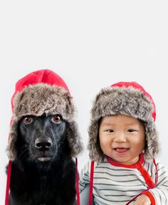 Jasper and Zoey with warm hats during the polar vortex. Mom (and pro photographer) Grace Chon captures the cutest pics of her son Jasper and rescued pup, Zoey.  Guess which one is the hardest to get to sit still?