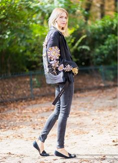 Elena Perminova wears an embellished leather jacket, skinny jeans, and black flats
