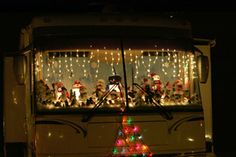 A fun way to decorate an RV windshield and dashboard with Christmas lights and decorations.