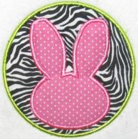 Free Easter Bunny Rabbit Circle Applique Embroidery Design. You can also add a letter or monogram to the center of the applique to personalize.