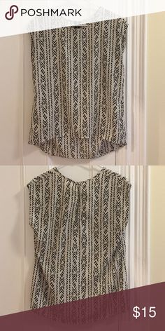 Patterned Sleeveless Top Cute patterned sleeveless top. Unknown brand. Missing some tags but it fits like a small. Soft silky fabric - I've tended to machine wash / hand dry. Good quality! Unknown Tops