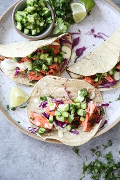This salmon tacos recipe is one of my favorite easy fish dinners. It's served on #glutenfree corn tortillas, topped with cucumber salsa and spicy jalapeno aioli! ♡ #healthy #easydinners #recipes #tacos #salmon #healthydinner #fast #quick #fishtacos | www.feedmephoebe.com
