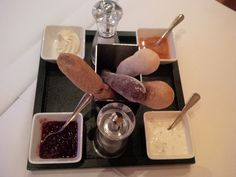 Different breads (thyme, tomato, malt) with cranberries, butter, tsatsiki, and pumpkin sweet and sour dip @ Restaurant Baccara