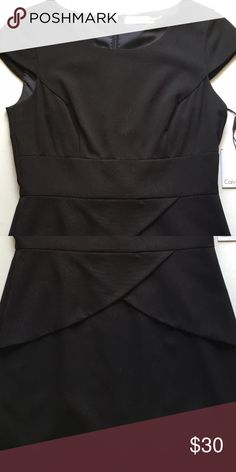 Calvin Klein Cap Sleeve Dress Chic little black dress that was never worn new with tags. Perfect for work or for a nice dinner out. Calvin Klein Dresses