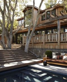 I have a soft spot in my heart for decks that preserve trees and are built around them. This one is unusual in that the stairs are also built around a tree. What a lovely spot to enjoy the view of the pool from.