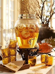 Cute idea!  Pare apples, then cut out faces and add to a clear pitcher of apple juice.  SPOOOKY!