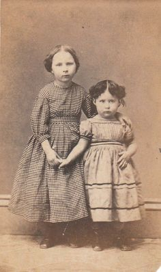 OMG those faces. Two sisters circa turn of the century. Eastern European? #VintageKidsFashion
