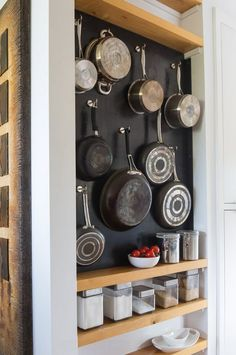 Last week I decided this was the month I was finally going to hang my pots and pans on the wall. My first step was to find an easy-to-install weight-bearing wall system for the seven pans I plan to clear out of the cupboard. Here's what I decided on: