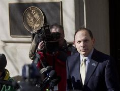 FILE - In this Feb. 24, 2015 file photo, Veteran Affairs Secretary Robert McDonald speaks to reporters outside VA Headquarters in Washington. More than one-third of calls to a suicide hotline for troubled veterans are not being answered by front-line staffers because of poor work habits and other problems at the Department of Veterans Affairs.  (AP Photo/Pablo Martinez Monsivais, File)