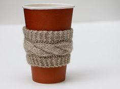 Coffee Cup Cozy - this is adorable, and an adorable gift for a coffee lover. Too bad I don't know how to knit :( Can you crochet a cable knit pattern?