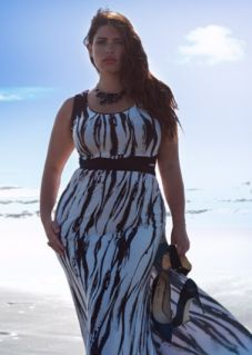 What a great dress for hot days and a great style for full figured women. The dress has wide straps so you can wear a supportive bra. The vertical pattern elongates her silhouette and the belt defines her waist. Repin this!